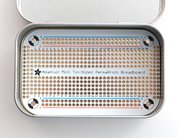 Adafruit Perma-Proto Mint Tin Size Breadboard PCB, shown with tin