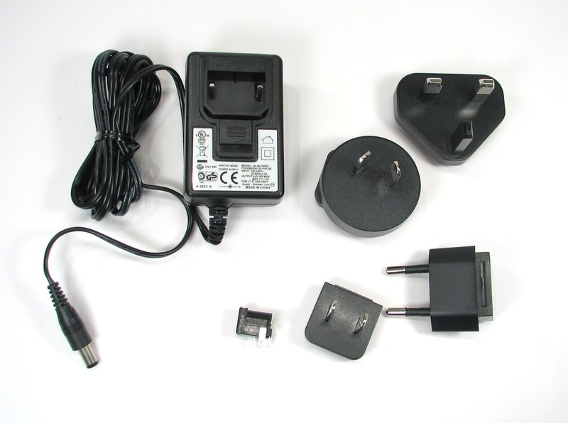 5 V international power supply and jack, shown with assorted plugs