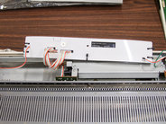 AYAB interface board, shown connected in knitting machine