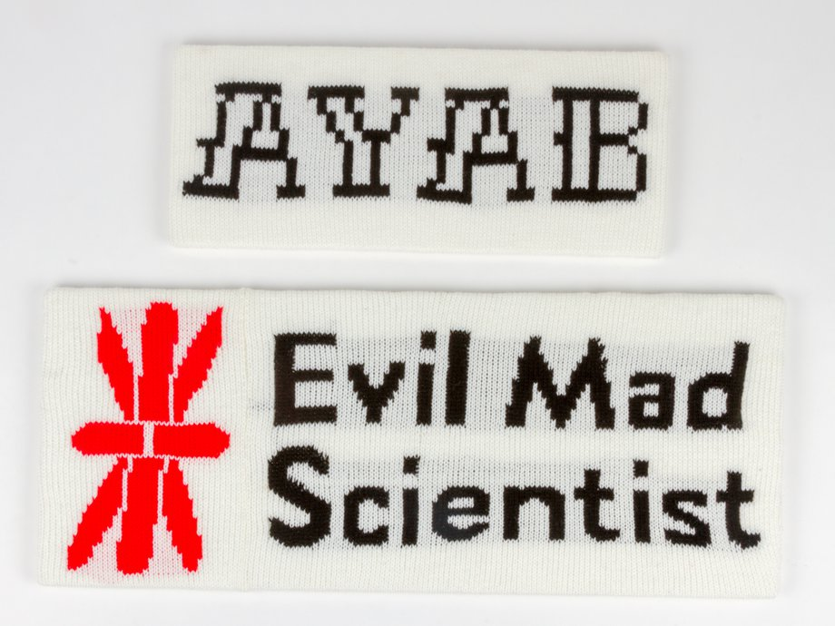 Machine knitted versions of the AYAB and the Evil Mad Scientist logos