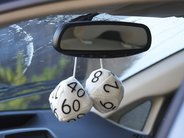 Action shot: Fully assembled fuzzy dice, installed on car!