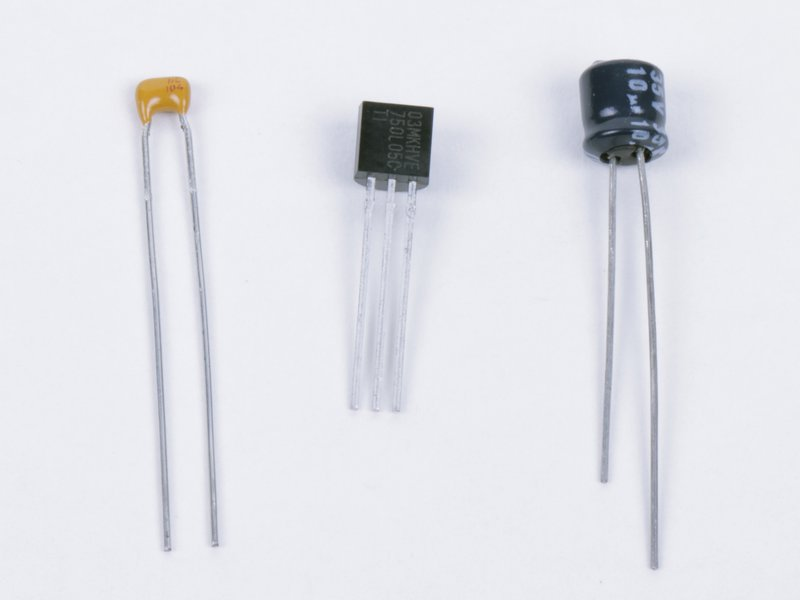 Voltage regulator and capacitors