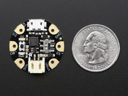 Gemma microcontroller board with quarter for scale