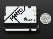 Adafruit Metro (back, with quarter for scale)