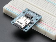 MicroSD Breakout board with headers soldered on and inserted into breadboard with MicroSD card (not included) shown in slot