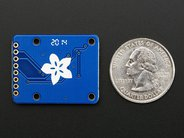 MicroSD Breakout board (reverse) with quarter for scale