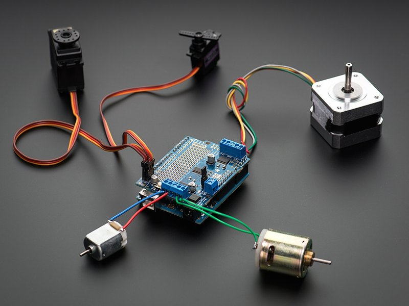 Motor Shield - shown with motors and Arduino (not included)