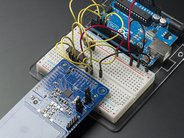 PN532 NFC/RFID controller breakout board shown hooked up to breadboard and Arduino (not included)