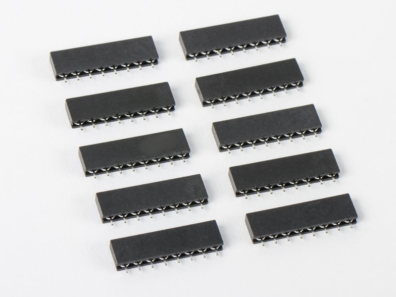 Set of ten 8-pin strips shown in carrier sockets